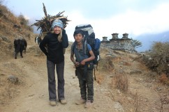Trekker with porter Tsum valley
