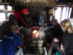 Trekkers warming themsleves in the Kitchen