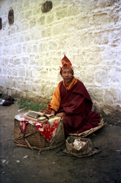 Mendicant monk seen on the street of Lhasa