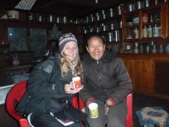A trekkers posing with a Tea House owner in Everest region