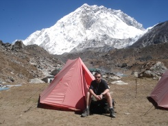 A trekker resting at a camp in everest region