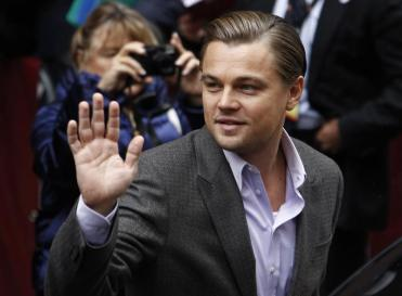 """Actor DiCaprio waves to supporters as he arrives for a photocall to promote the movie """"Shutter Island"""" at Berlinale in Berlin"""