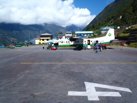 A Twin Otter resting at Lukla airport's runway