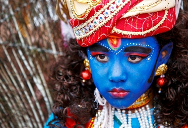A child enacting as a Hindu God Krishna