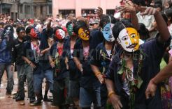 People donning masks duing Gai Jatra