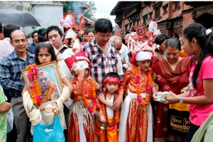 Children in costume marching along the procession during Gai Jatra in Kathmandu