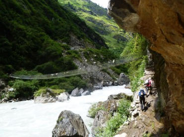 Crossing suspension bridge during Annapurna Trek