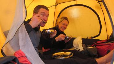Rob and Marisa dining inside their tent