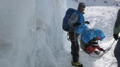 Pem Sherpa directing porters at Mera peak