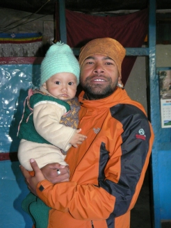 Sudip holding a local toddler at Upper Mustang