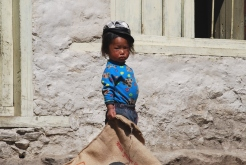 A young Sherpa girl posing for a snap at Namche Bazaar
