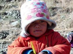 A toddler playing at Gurung village in Kaski district