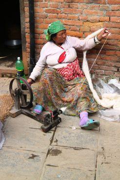 Elder Newari woman weaving clothes