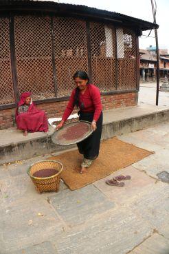 Newari woman doing household chores