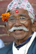 A newari man smiling for the camera