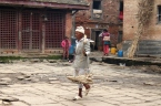 Newari householder carrying goods