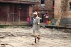 Newari householder carrying goods