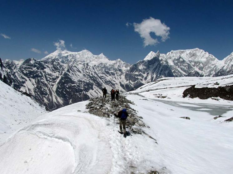 Trekkers Crossing Larkya La Pass